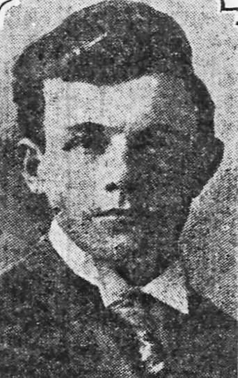 Grainy black and white photo of young man wearing jacket and tie.