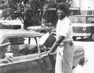Man opens car door.