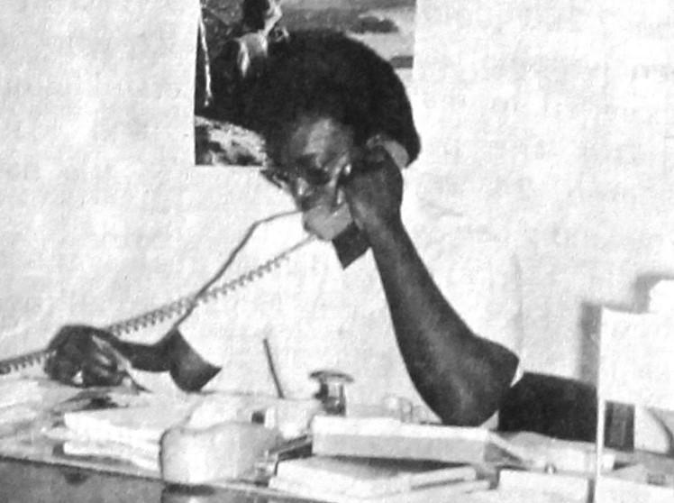 Man makes a phone calls at a desk.