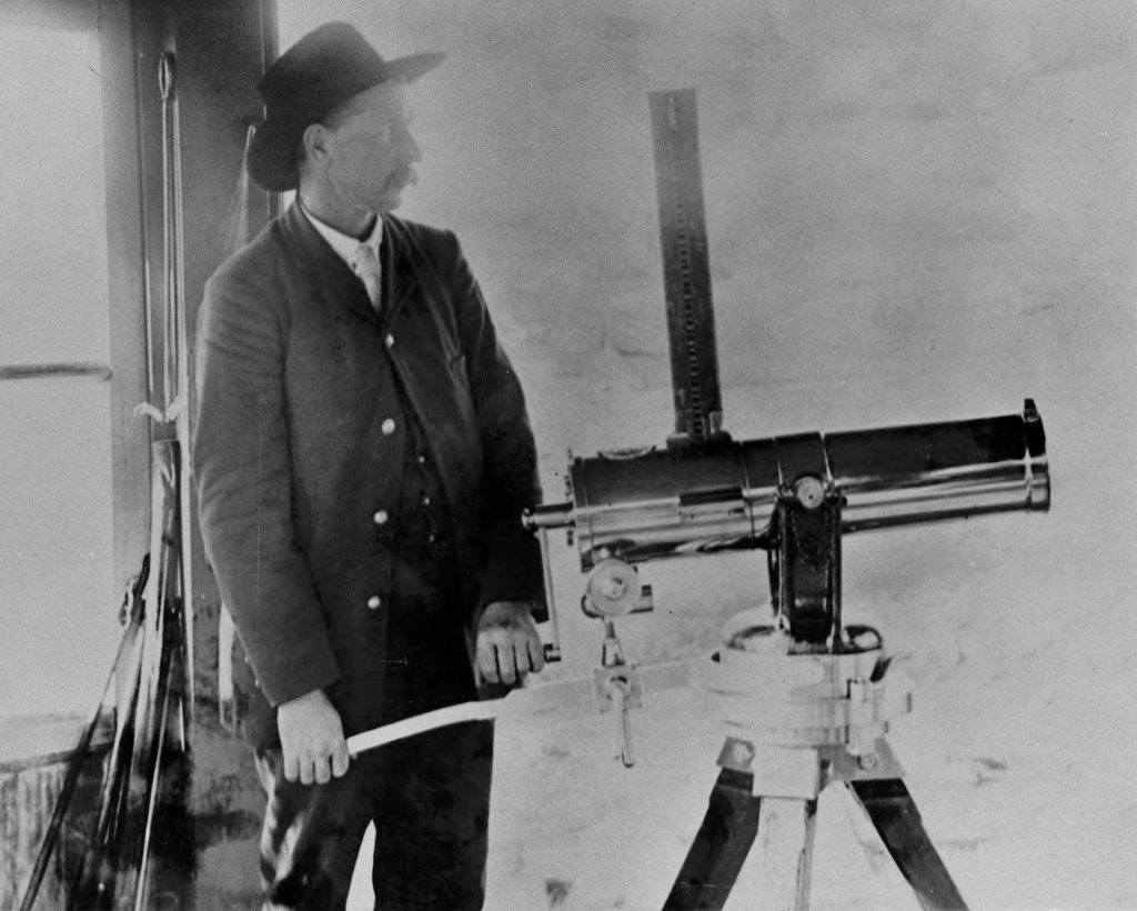 Correctional officer with hat and a big old-fashioned Gatling gun.