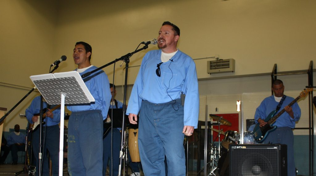 Inmates sing and play instruments at a CDCR prison.