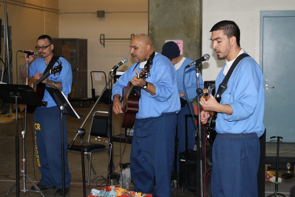 CDCR inmates play instruments and sing at California Correctional Institution.