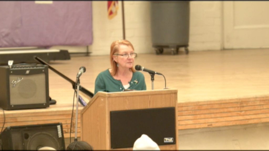 CIW chaplain speaks during the Day of Peace and Reconciliation.
