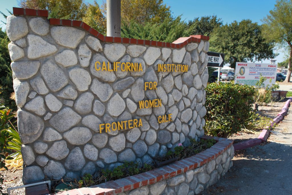 A rock sign says California Institution for Women, Frontera, CA.