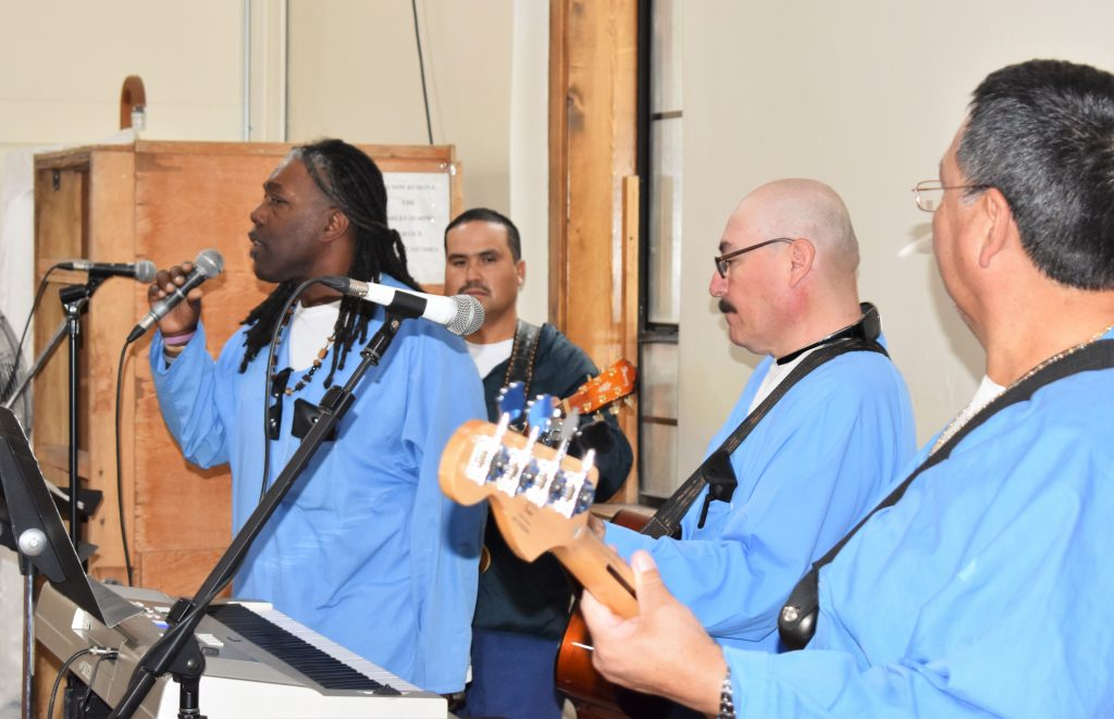 Inmates play instruments and sing during the Day of Peace and Reconciliation at Folsom State Prison.