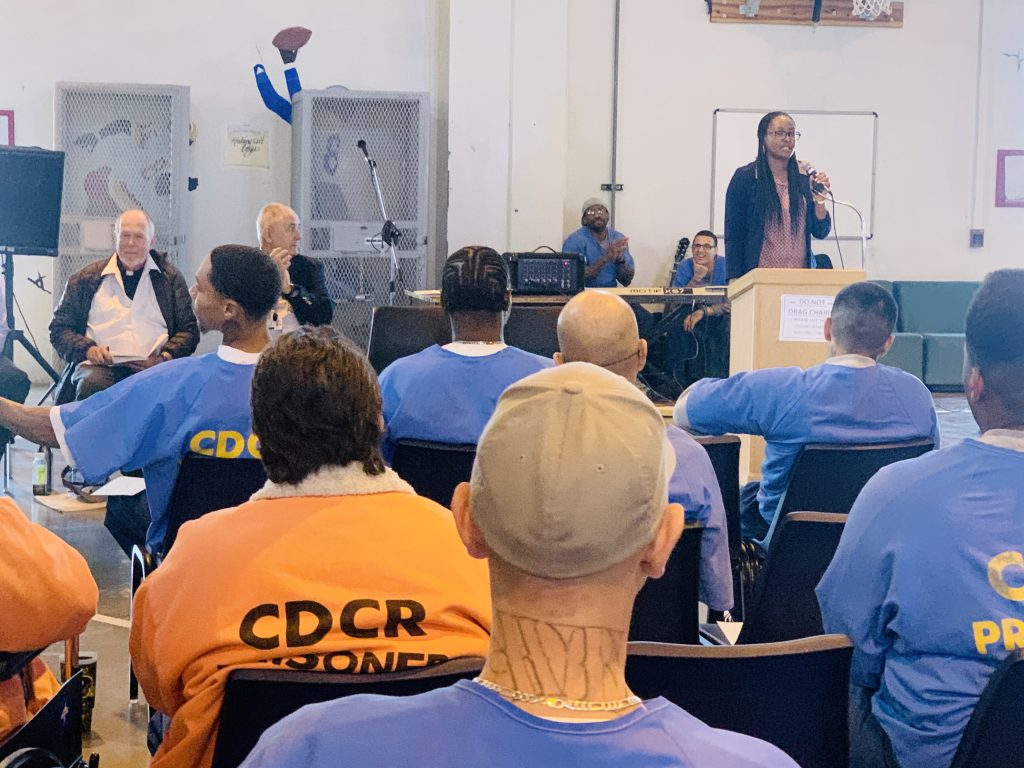 Woman stands in front of group of inmates at Los Angeles County prison in Lancaster.