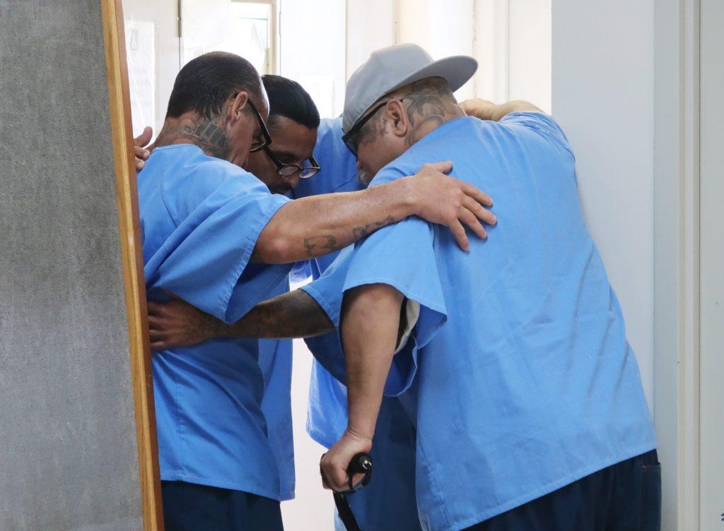 Inmates huddle in at RJ Donovan Correctional Facility.