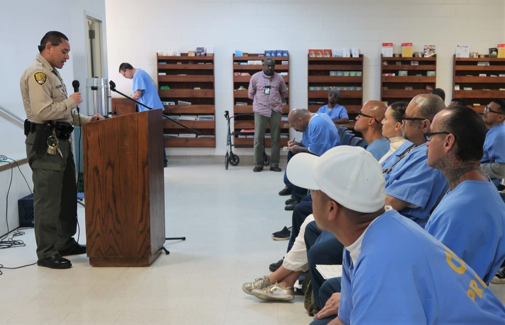 CDCR officer speaks to inmates at RJ Donovan Correctional Facility.