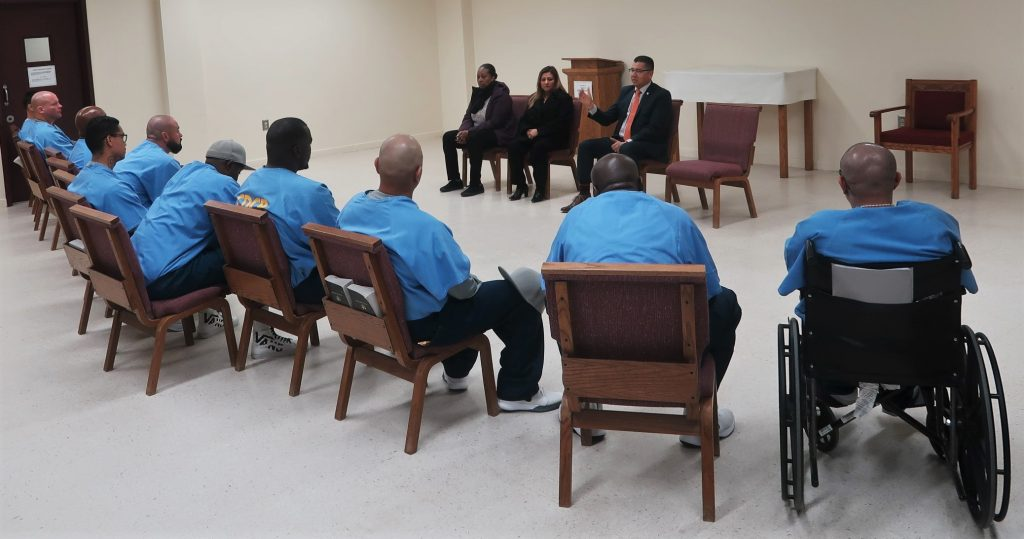 CDCR Secretary Ralph Diaz speaks to inmates in a room at Substance Abuse Treatment Facility.