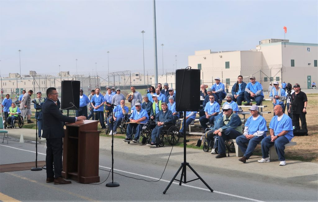 CDCR Secretary Ralph Diaz speaks to a large group of inmates.