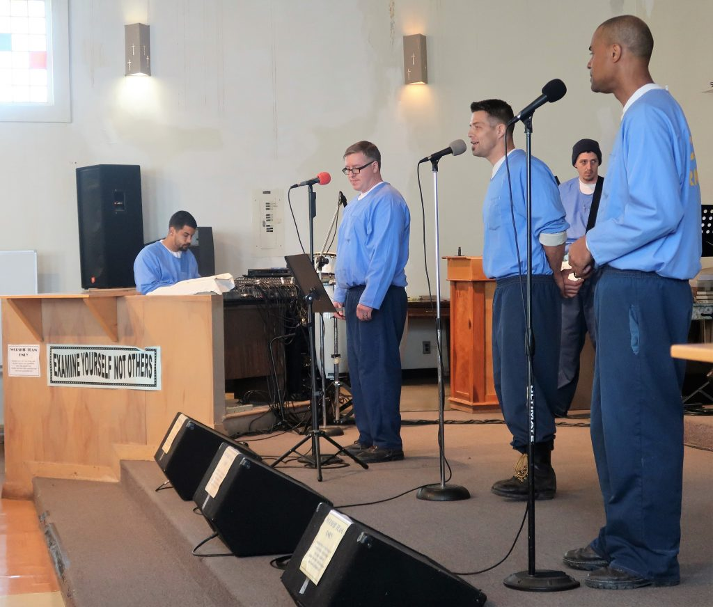 Sierra Conservation Center inmates perform on stage.