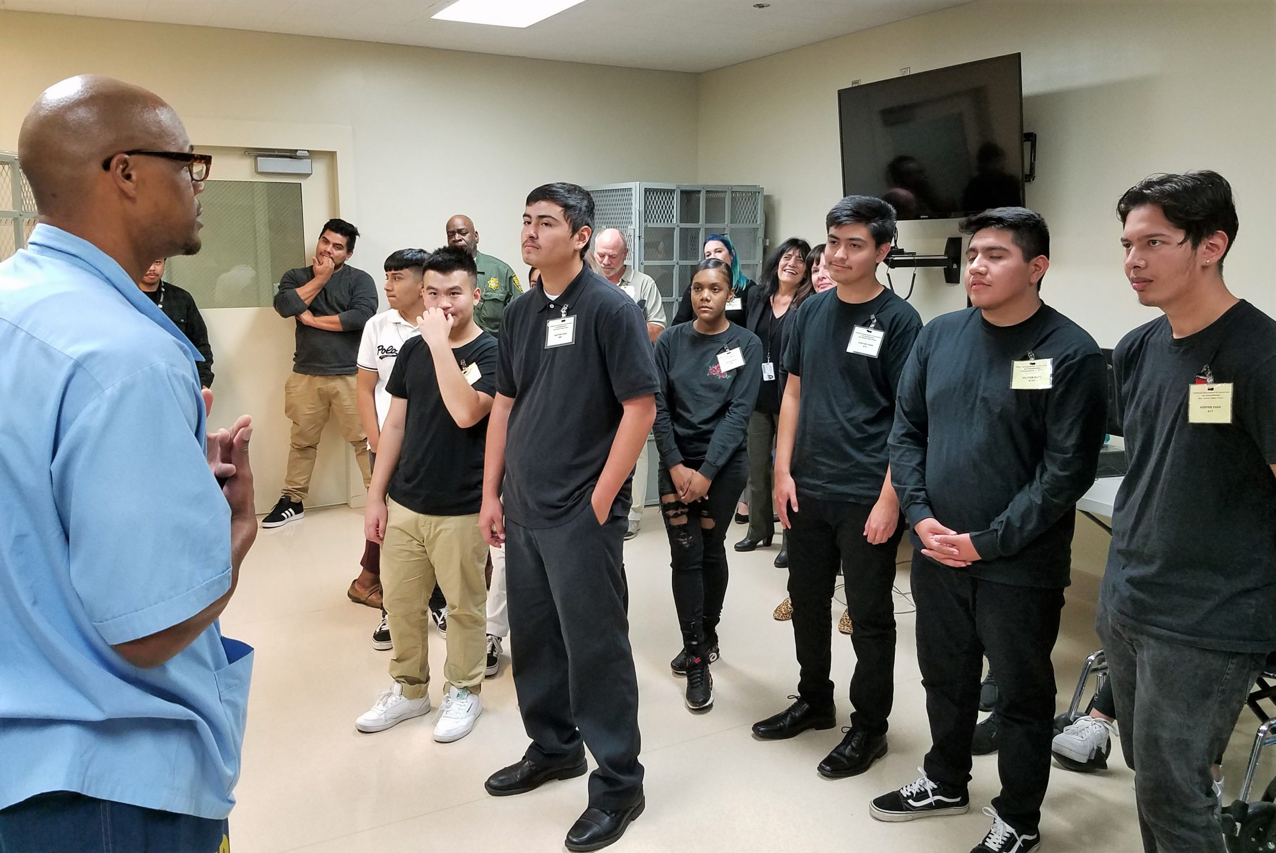 High school students listen to a prison inmate talk about rehabilitation.