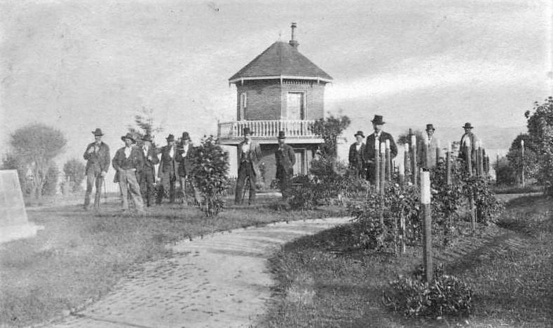 Prison guards stand near guard house.
