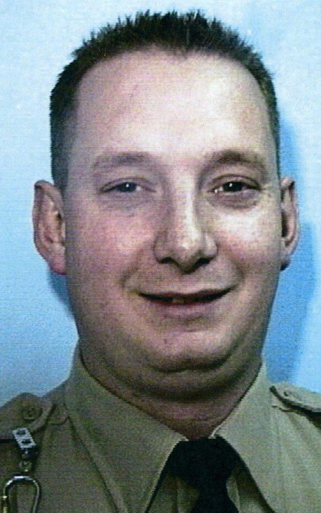 Man in uniform facing camera