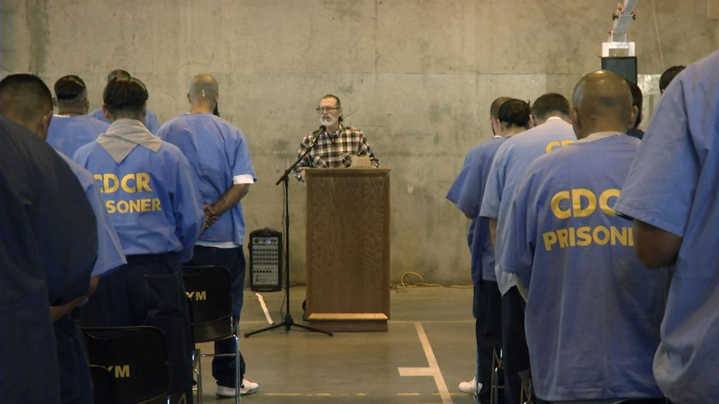 Chaplain speaks to inmates at Wasco State Prison-Reception Center.