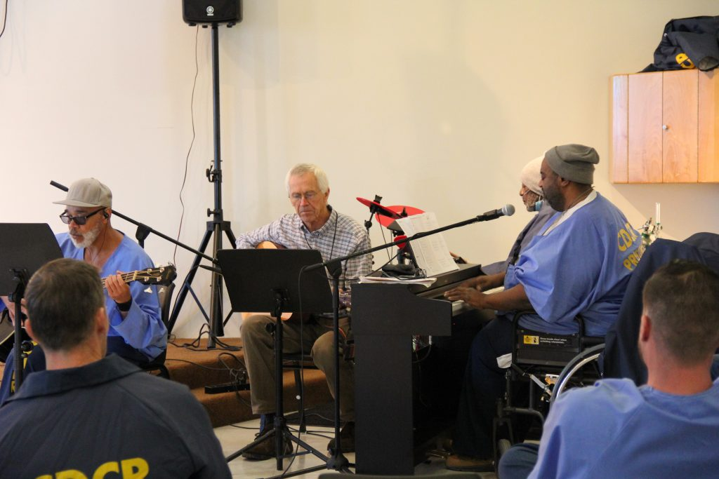 CHCF inmates play musical instruments during the Day of Peace and Reconciliation.