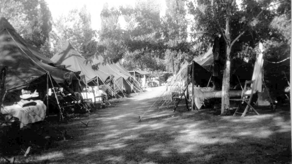 Tents line a small roadway.