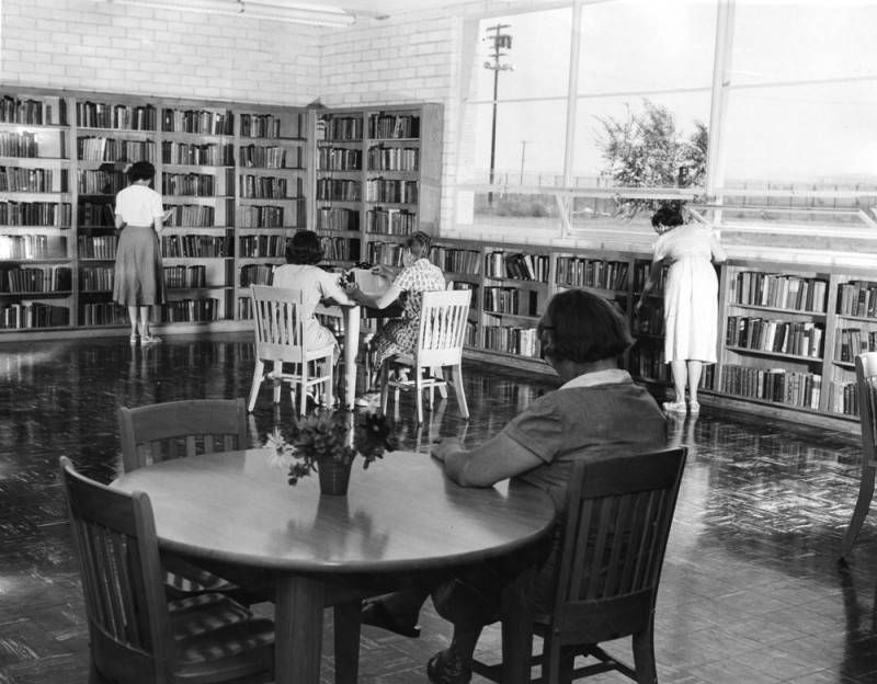 Female inmates check out the library at CIW.