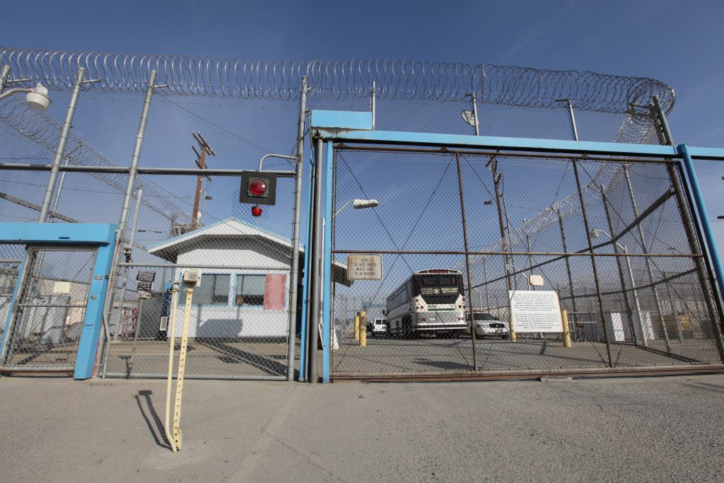 Gates, a fence and razor wire at Corcoran prison.