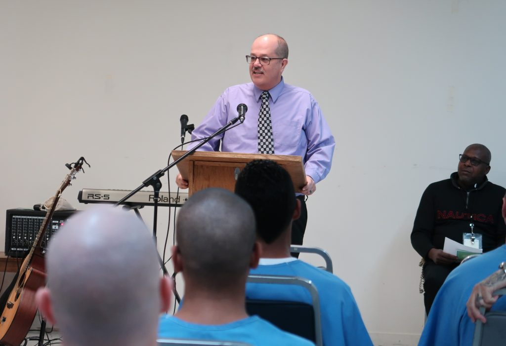 Ironwood State Prison Warden Neil McDowell speaks to inmates.