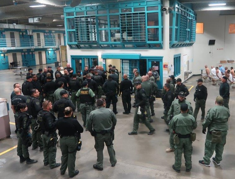 CDCR staff prepare to search cells at California State Prison, Los Angeles County.