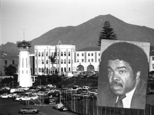 Photo of a man superimposed over San Quentin State Prison.