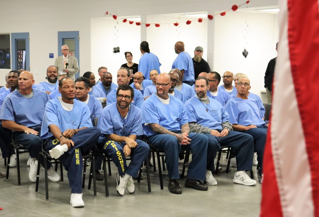 Richard J. Donovan Correctional Facility inmates gather to watch a documentary screening.