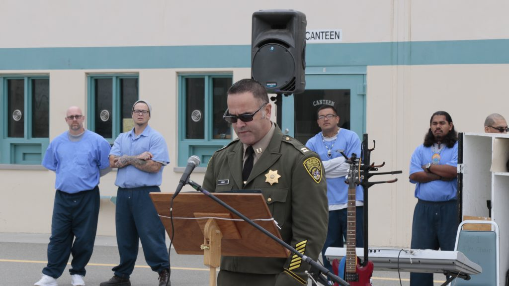 Correctional staff member speaks to inmates at Substance Abuse Treatment Facility.