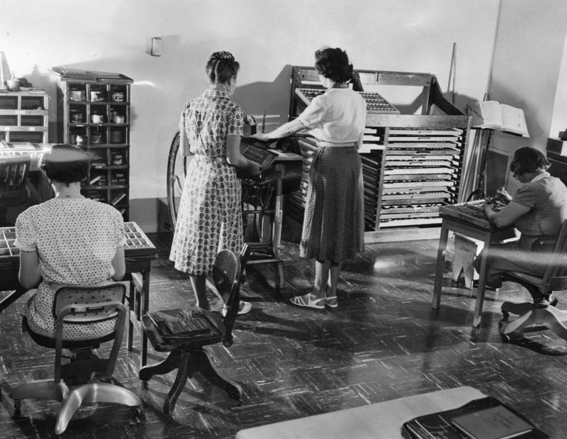 Female inmates set type and work in a printing plant.