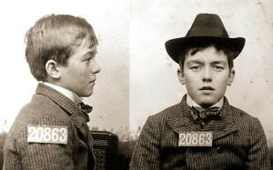 Young teen boy mugshot with numbers 20863.