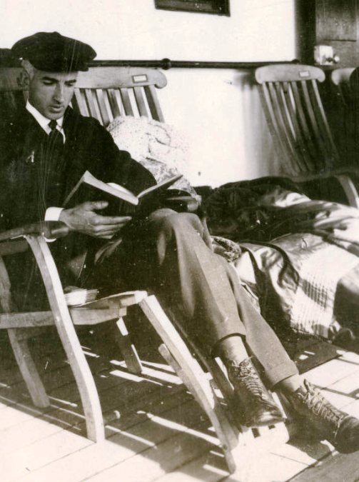 San Quentin doctor Leo Stanley sits in a rocking chair while reading a book.