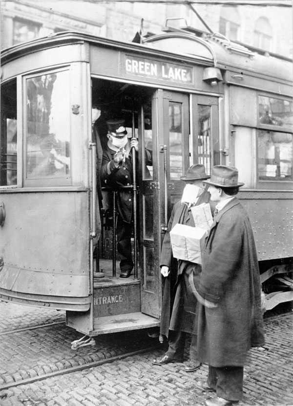 Man without a mask is denied entry on a trolley car.