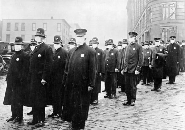 Police officers wear masks.
