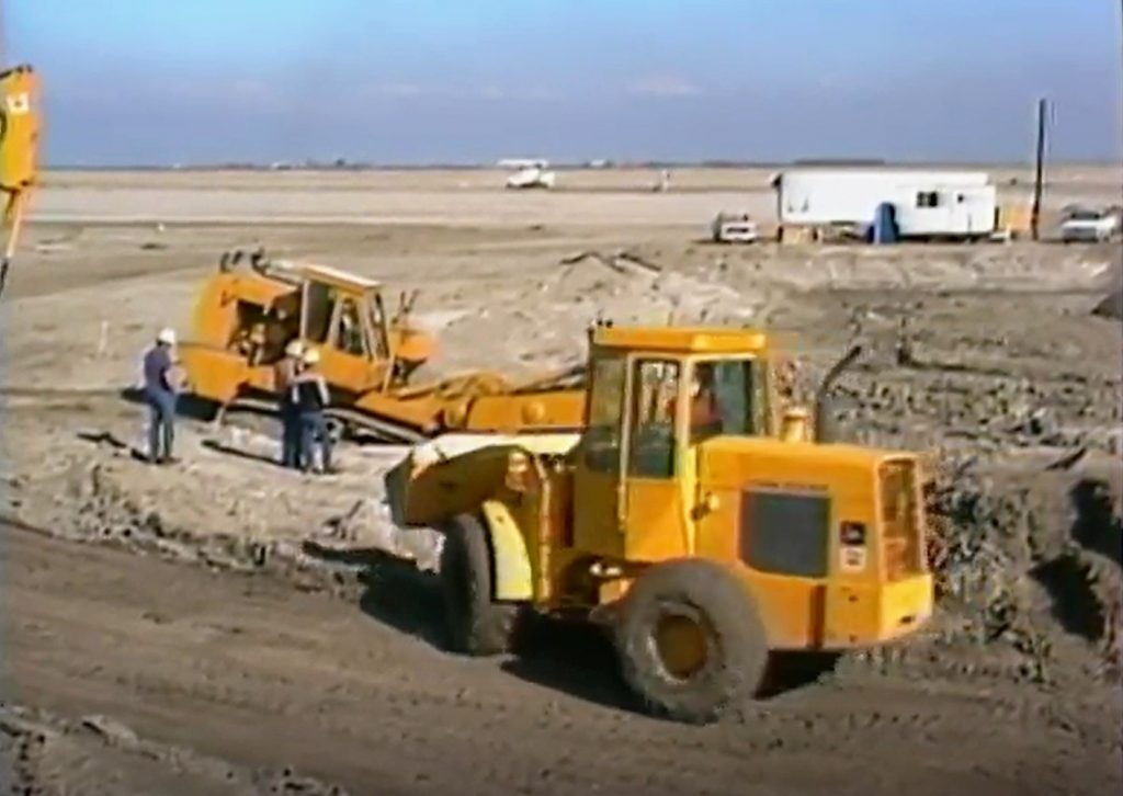 Heavy equipment operates on a work site constructing a new prison in Corcoran.