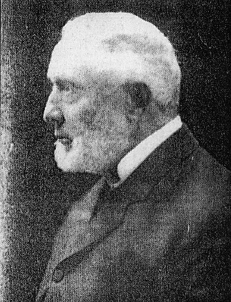 Side view of a man wearing a jacket and tie.