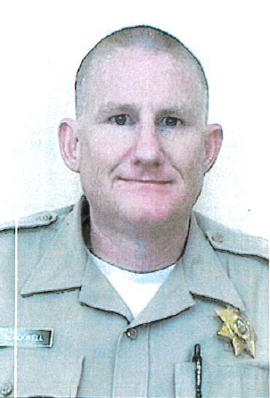 Man in correctional officer uniform.