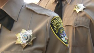 female and male correctional officer uniforms.