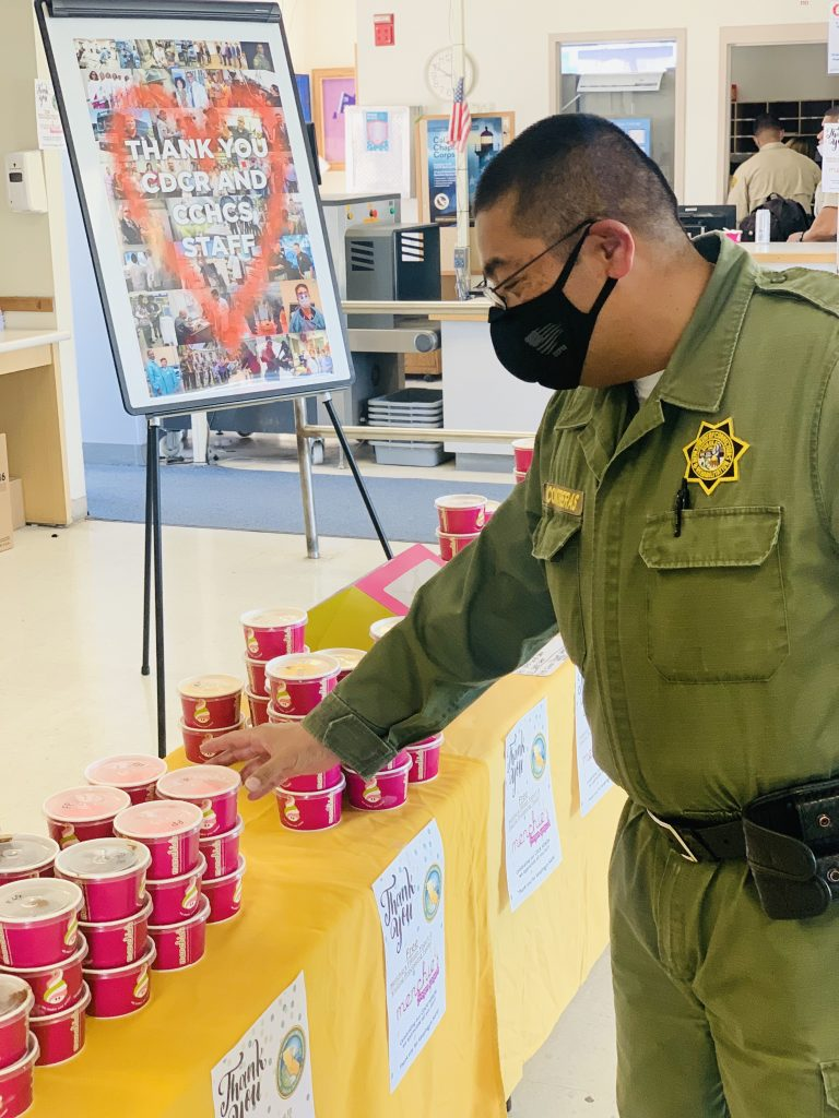Correctional officer selects some frozen yogurt.