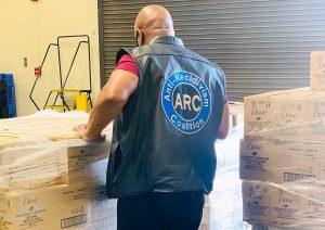 ARC employee facing backwards packing soaps