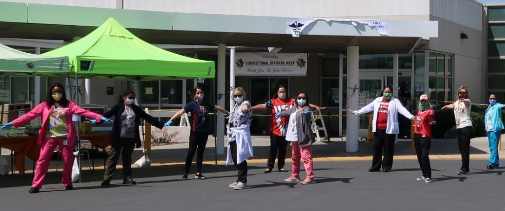 Medical staff stand outside a prison.