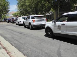 Law enforcement vehicles follow a hearse.