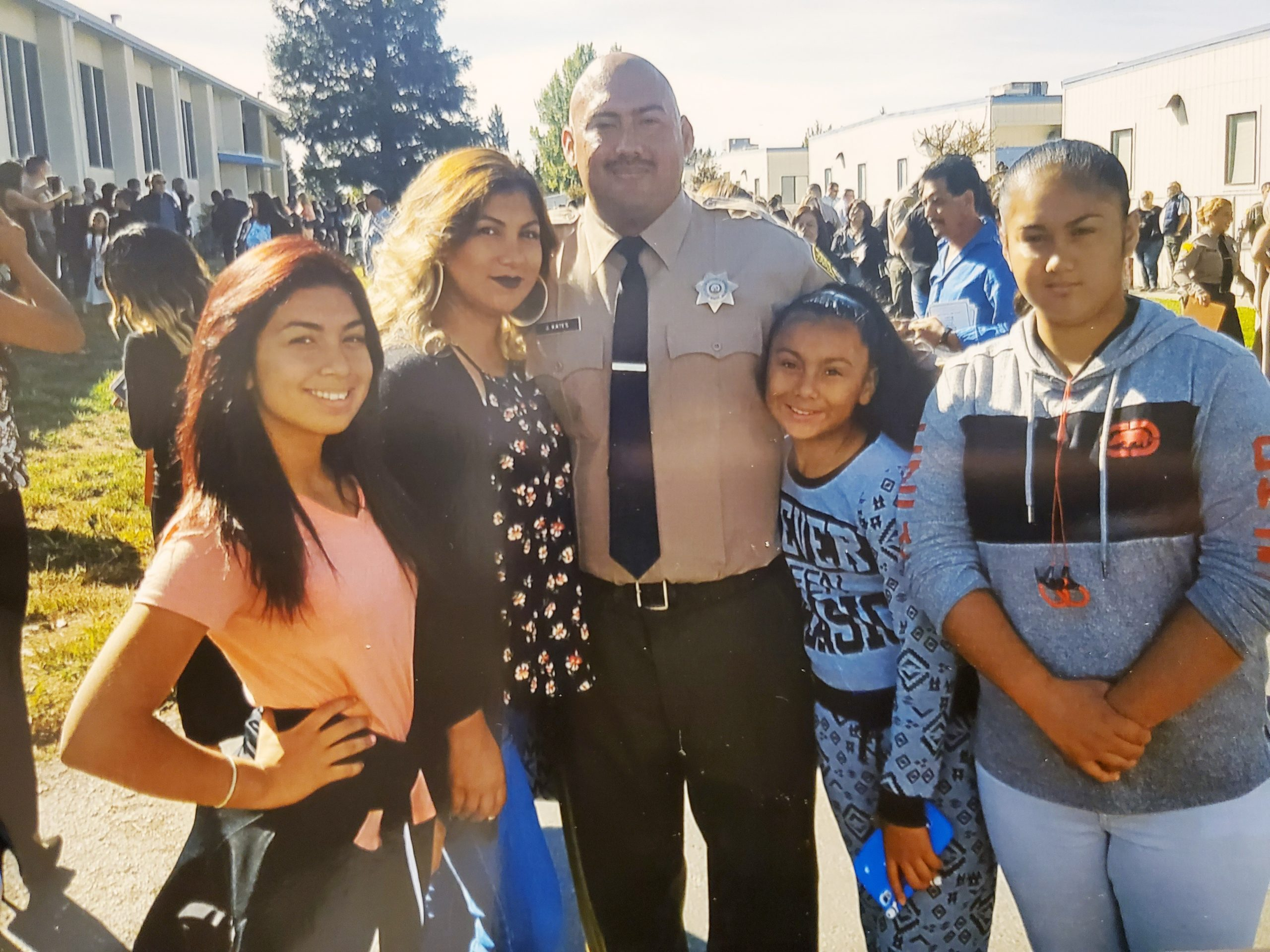 Man in correctional officer uniform with his wife and three daughters.