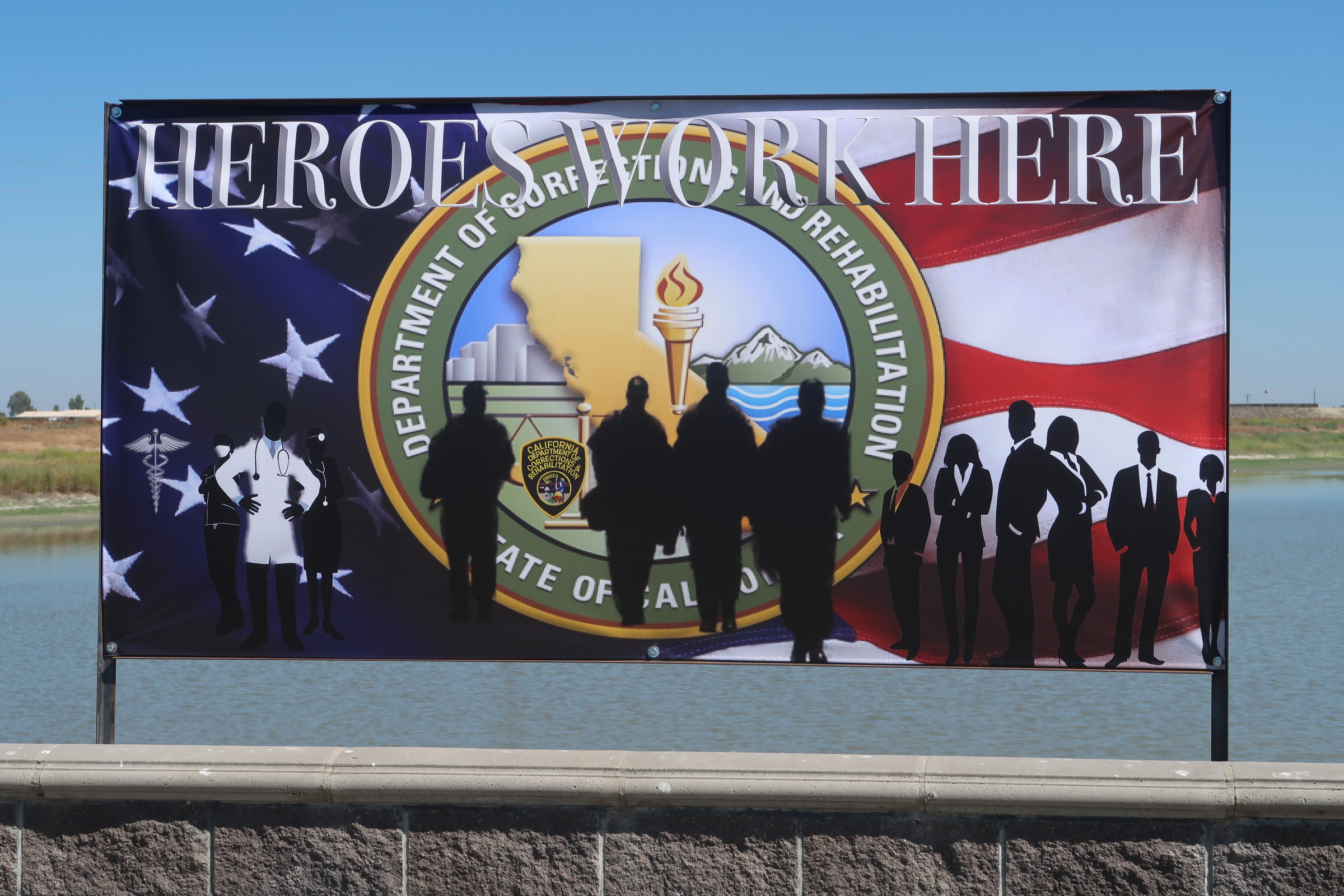 Heroes work here sign with the CDCR logo and an American flag.