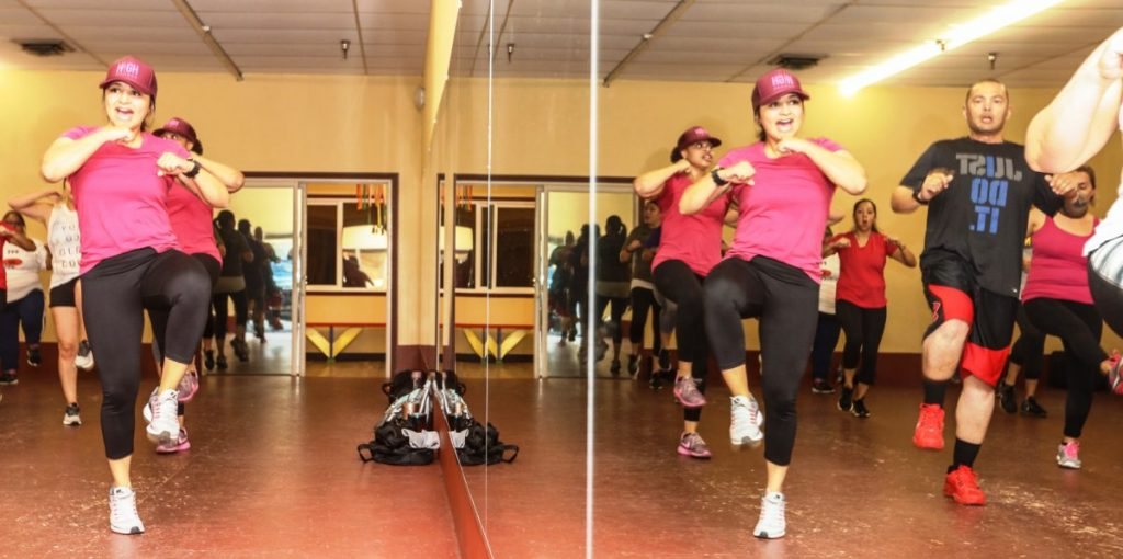 Woman leads a fitness class.
