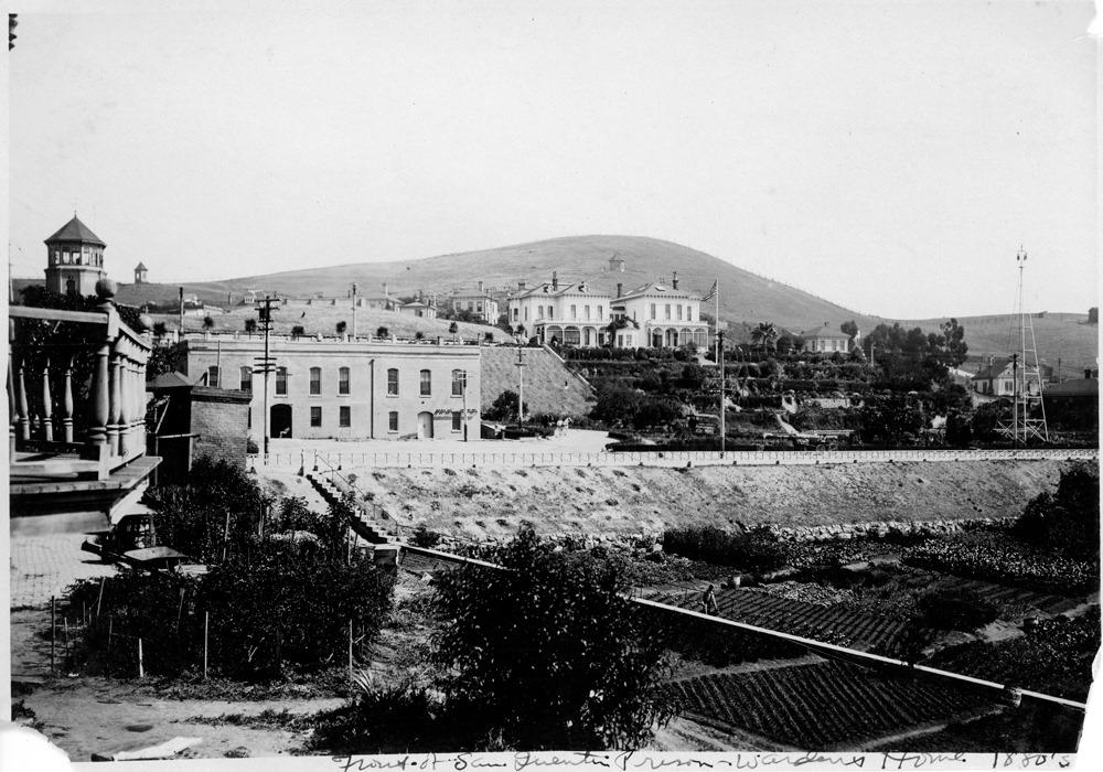 San Quentin prison buildings, a garden a large house.