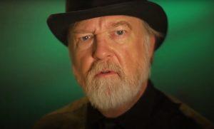 Bearded man wearing a hat.