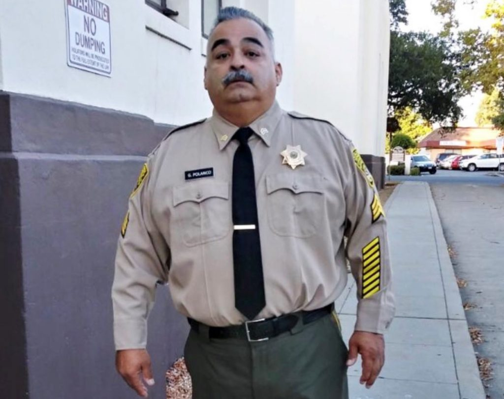 Man in sergeant's uniform.