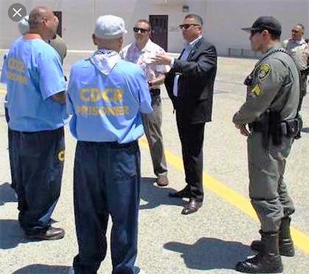 Secretary Diaz speaks with inmates.