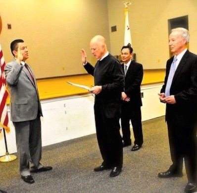 Governor Brown swears in Ralph Diaz.