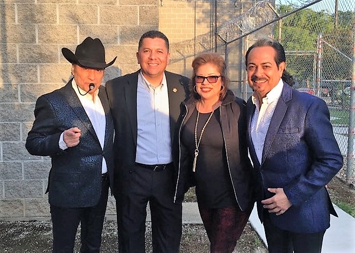 """Secretary Diaz with his wife Maria, during the filming of the Netflix documentary """"Los Tigres del Norte at Folsom Prison"""" with members of the band."""